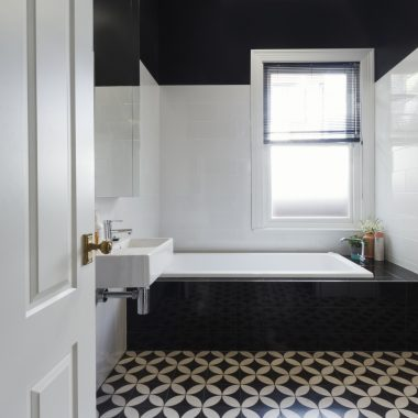 Designer bathroom renovation with black and white floor tiles horizontal