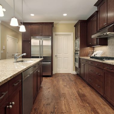 Kitchen in suburban townhome with family room view