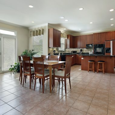 Large kitchen with redwood cabinetry and eating area